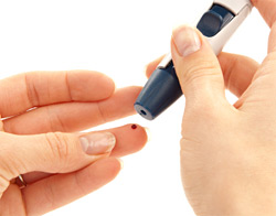 woman checking blood sugar levels